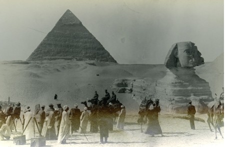 Sphinx and Great Pyramid of Giza with crowd in front . 1918.